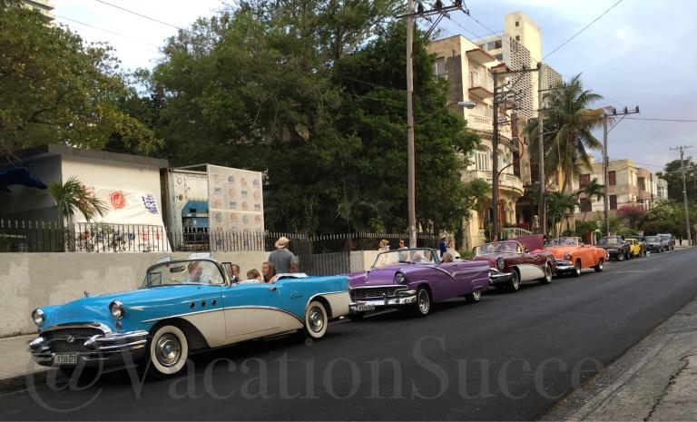 Vintage Cars on Modern Havana Boulevard